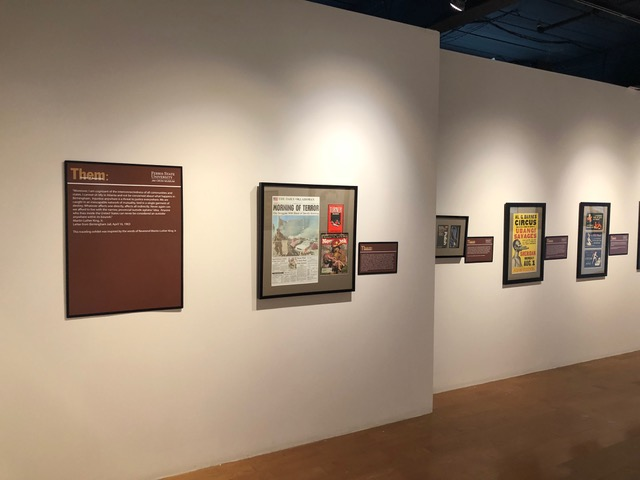 artifacts of racism displayed on gallery wall