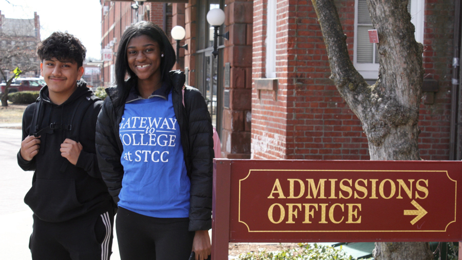 Gateway to College students with Gateway T-shirt next to Admissions Office sign