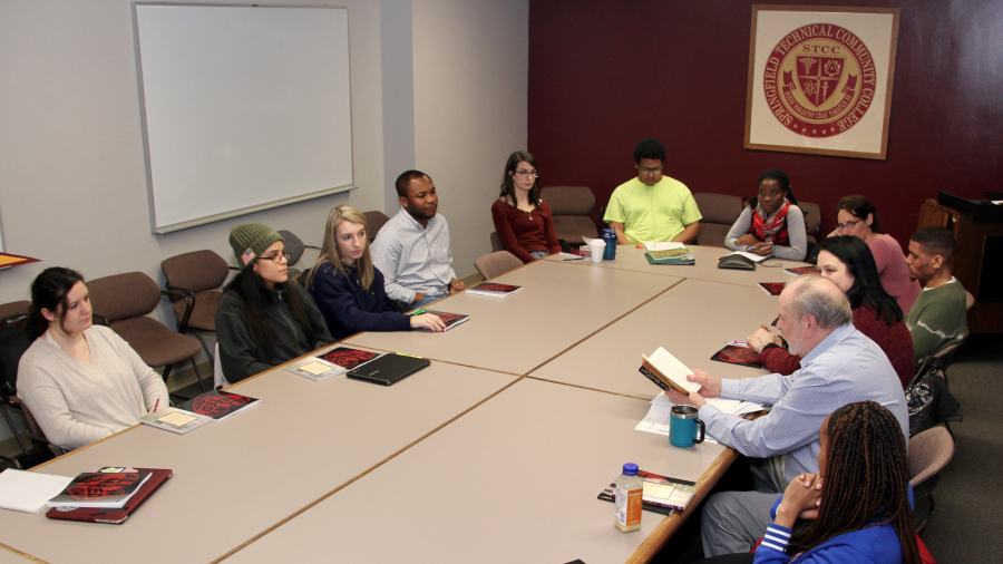 honors program students around meeting table