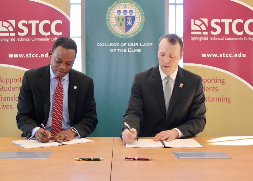 Presidents sign during ceremony for CIT transfer programs