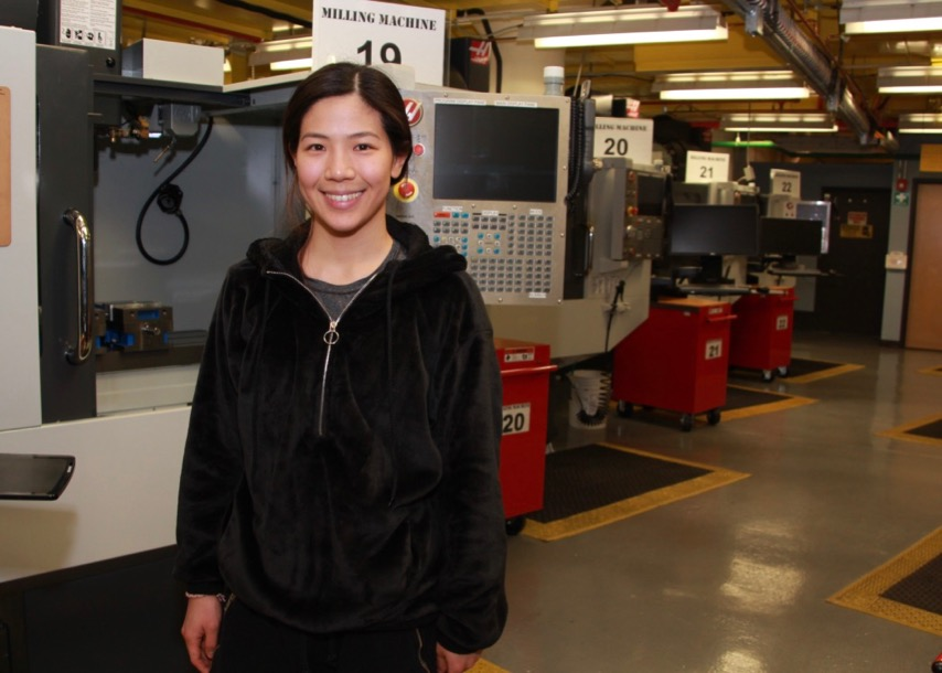 Student Robin Song, a working engineer, stands in MET lab
