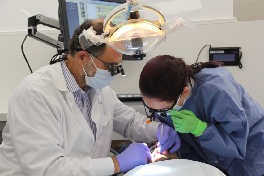 A student assists a dentist at the dental hygiene clinic