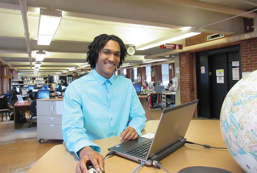 Student at computer in the library