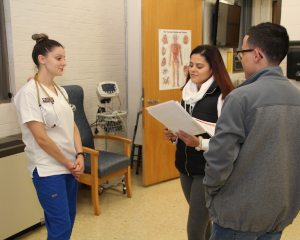 nurse speaking to two students