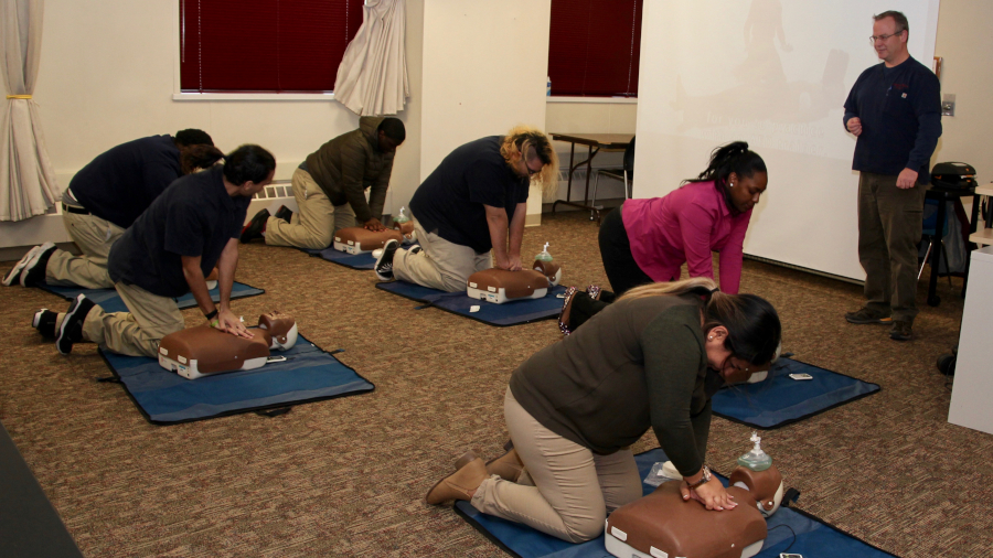 Students practicing CPR on dummy busts